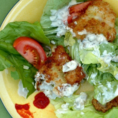 fried cod and oysters on salad