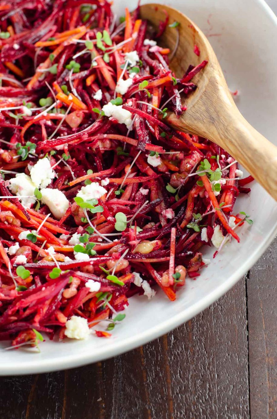 raw beet salad in a white bowl