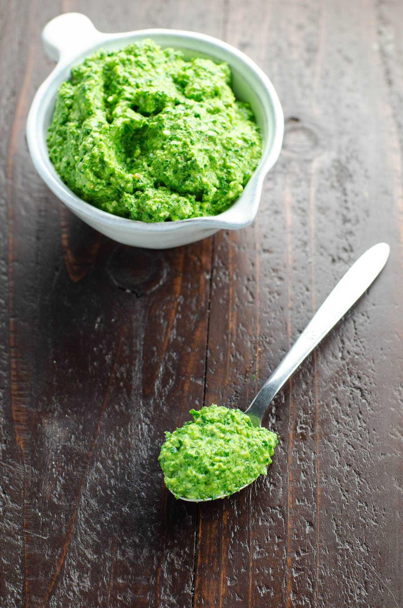 A bright, spicy ramp pesto recipe from Umami Girl makes the most of this seasonal ingredient. Basil rounds out the flavor and spinach keeps it green. #ramps #pesto
