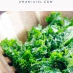 massaged kale salad with nutritional yeast in a wooden bowl