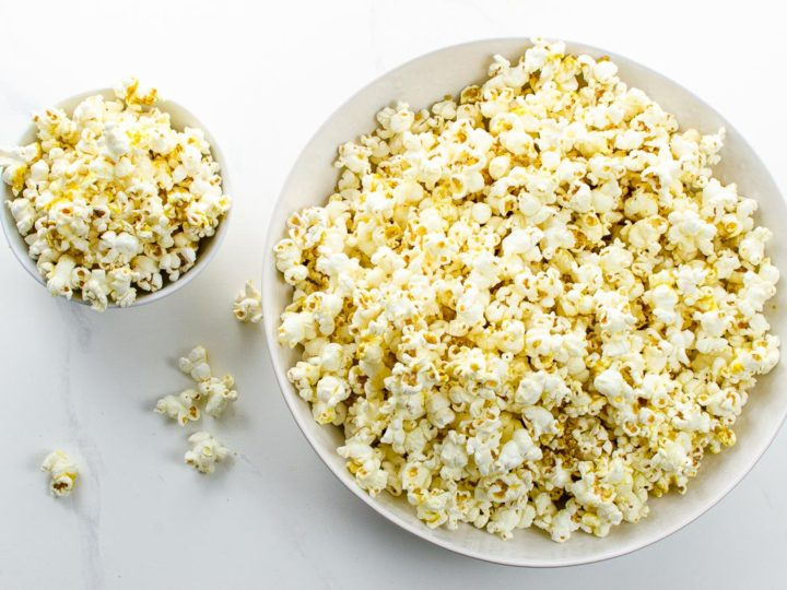 popcorn with nutritional yeast in white bowls