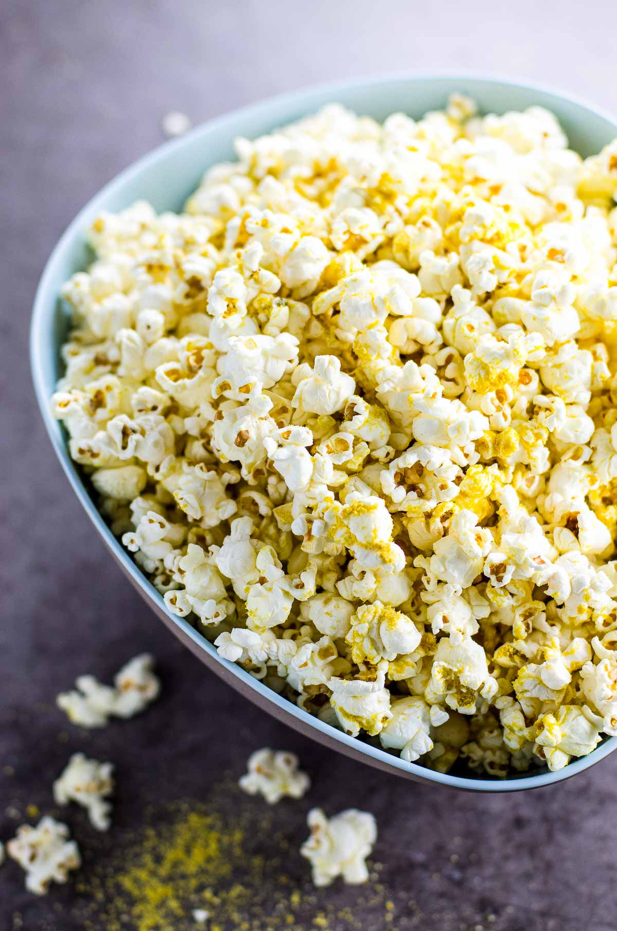 popcorn with nutritional yeast in a blue bowl