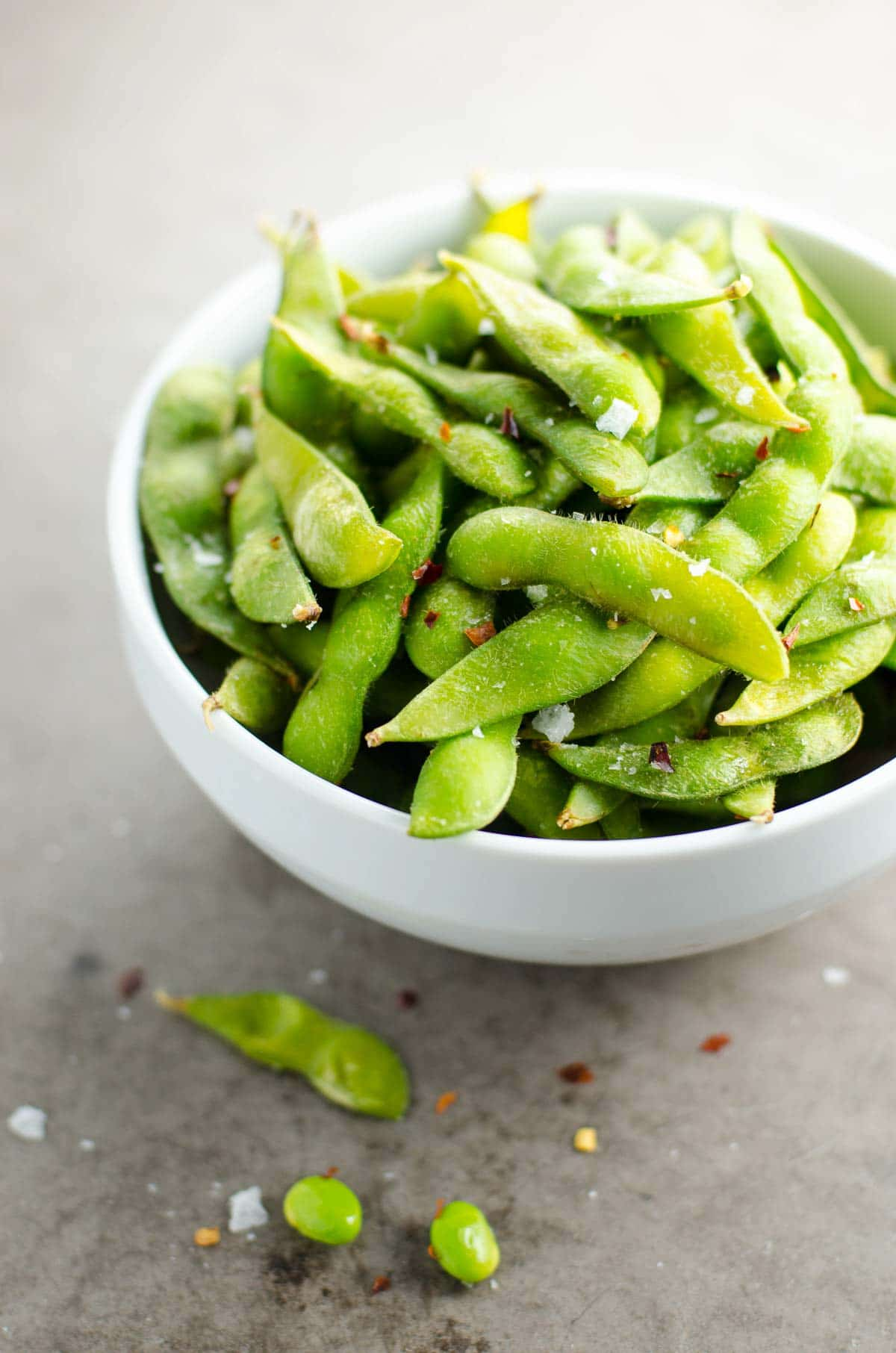 Wagamama-style chili salted edamame in a white bowl