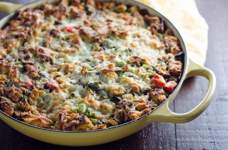 This make ahead healthy breakfast casserole is flavorful, cheesy, packed with protein and much lighter than traditional breakfast casseroles. Perfect for brunch and serving a crowd!