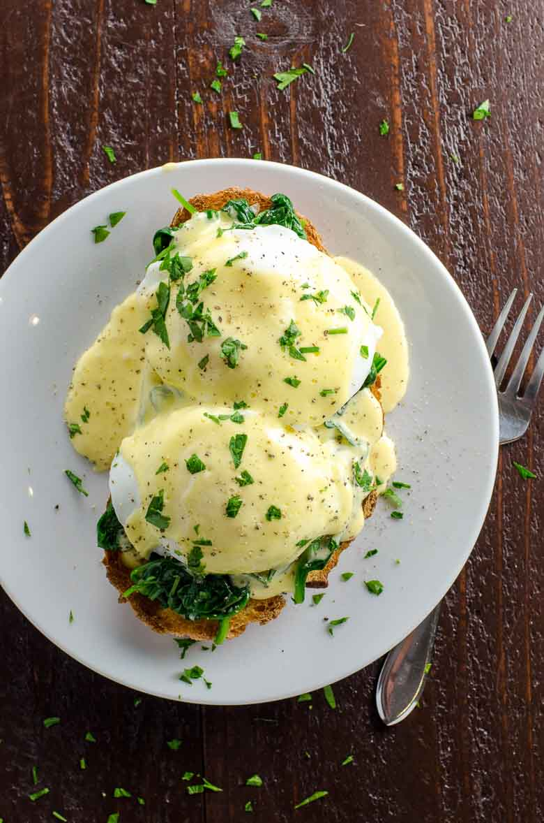 Eggs Florentine with blender hollandaise on a white plate