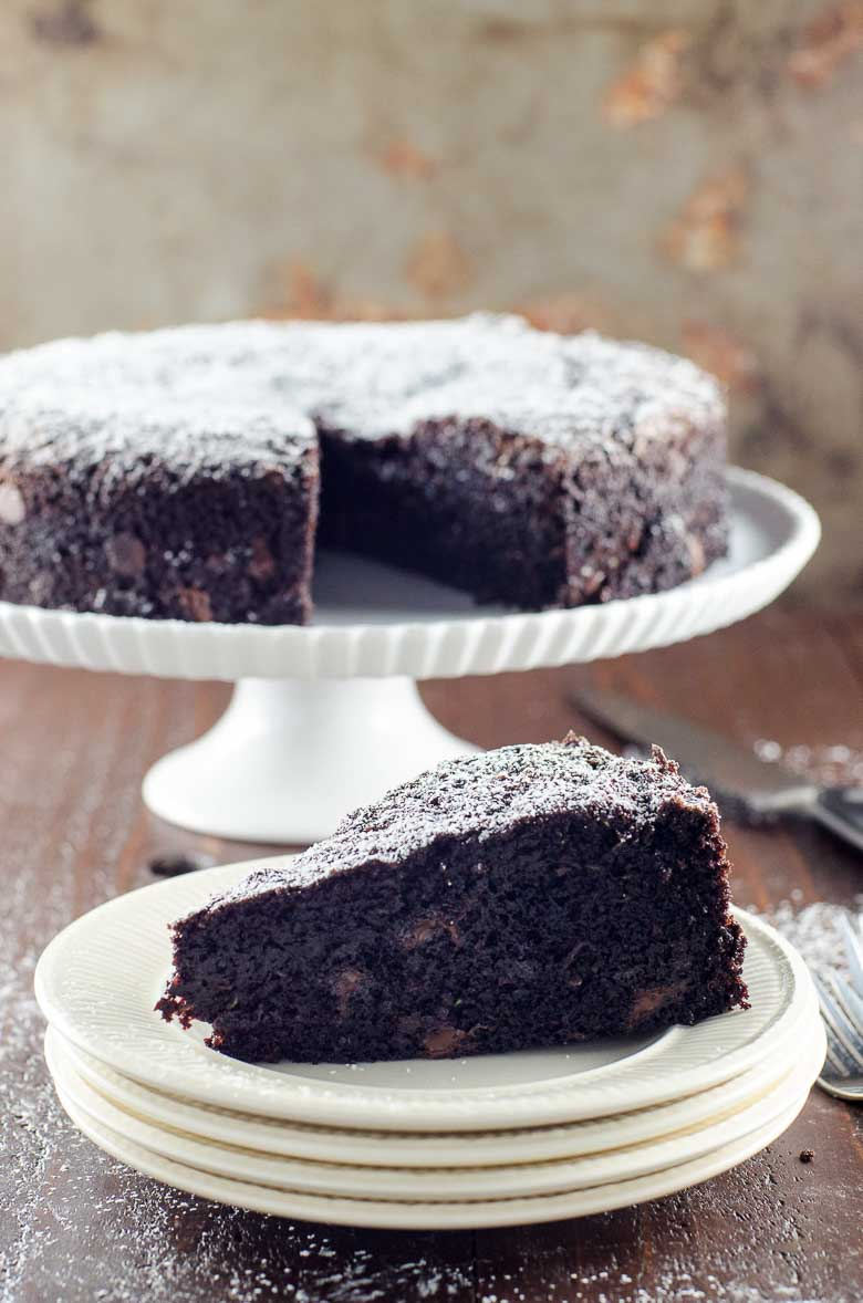 a slice of chocolate zucchini cake dusted with powdered sugar
