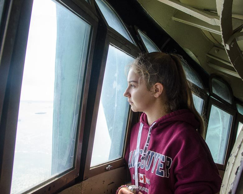 Gazing out from the Crown of the Statue of Liberty 780 | Umami Girl