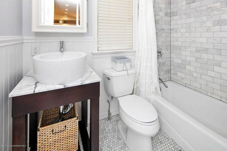 Honed Carrara Marble Subway Tile and Hex Tile Bathroom 503 River Road Fair Haven 780 | Umami Girl