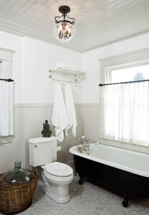 Black and white bathroom hex tile black tub | Umami Girl