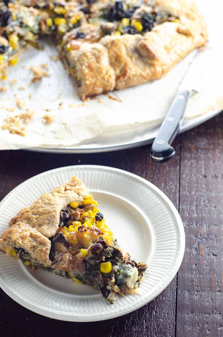 Slice of savory galette recipe on a plate