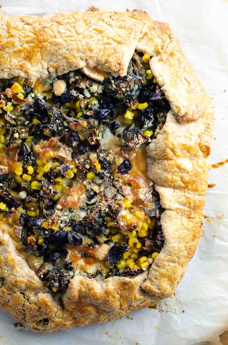 savory galette with golden brown crust, filled with cooked vegetables