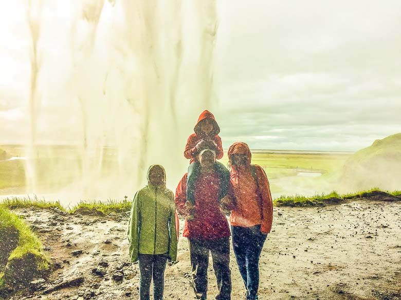 Family Under Seljalandsfoss Waterfall Iceland South Coast Golden Circle 780 | Umami Girl