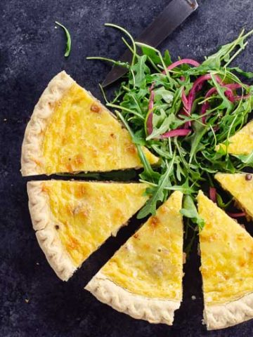 quiche slices and arugula salad