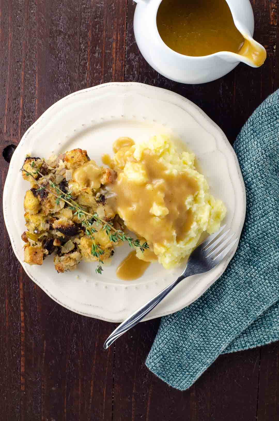 vegetarian gravy over a plate of mashed potatoes and stuffing