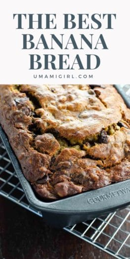 closeup of freshly baked banana bread in a loaf pan on a cooling rack