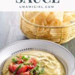 Creamy vegan queso in a bowl with tortilla chips