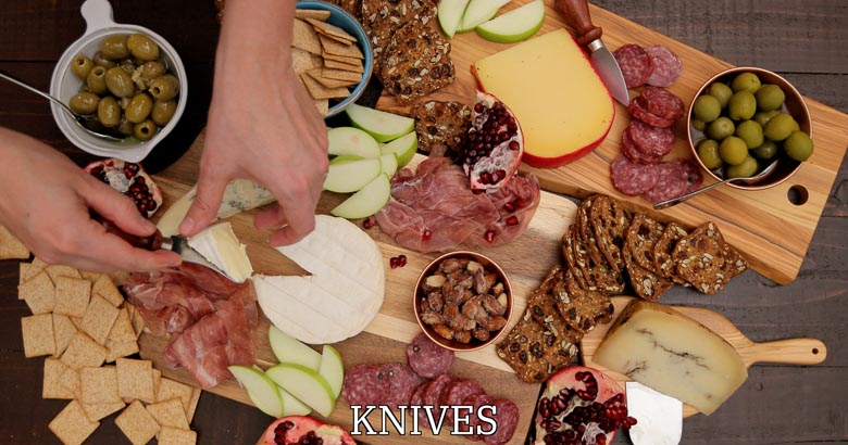 Cheese knives on a cheese board