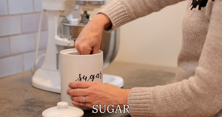 Measuring sugar for whipped cream