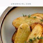 salt and vinegar broiled fingerling potatoes in a bowl;