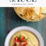 Creamy vegan cheese sauce in a bow with tortilla chips