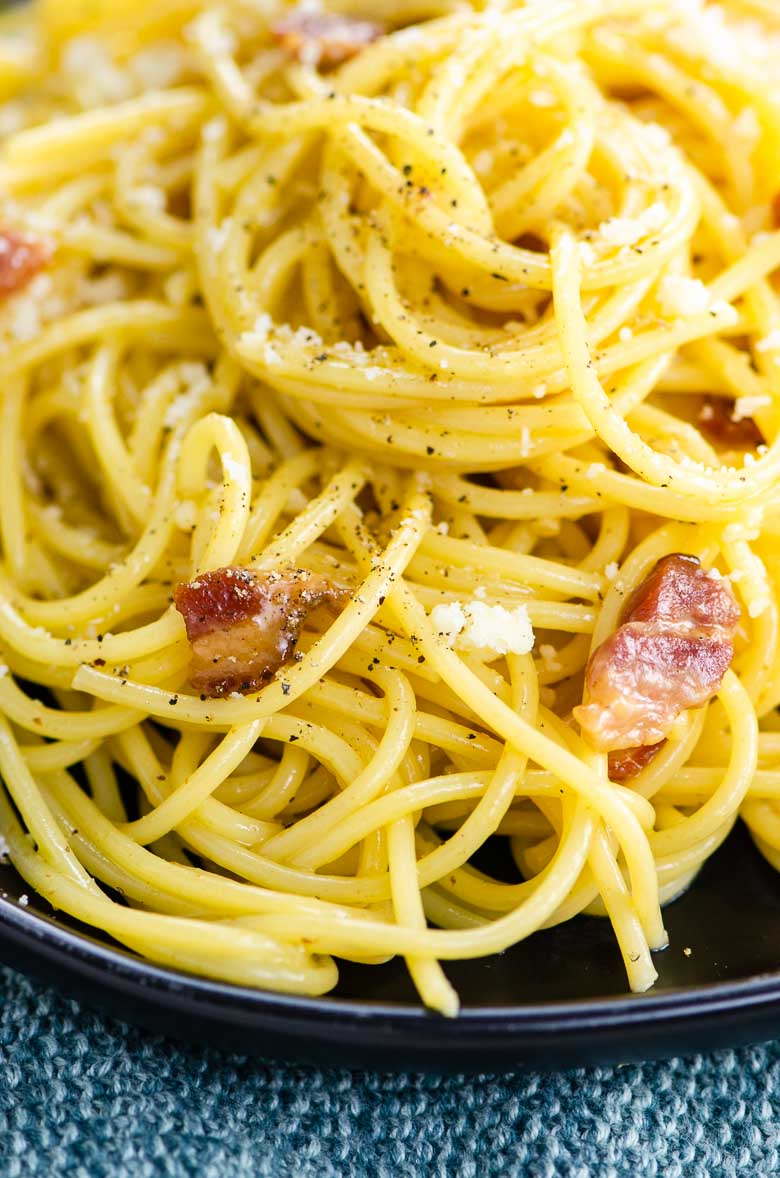 closeup of spaghetti with bacon and silky carbonara sauce