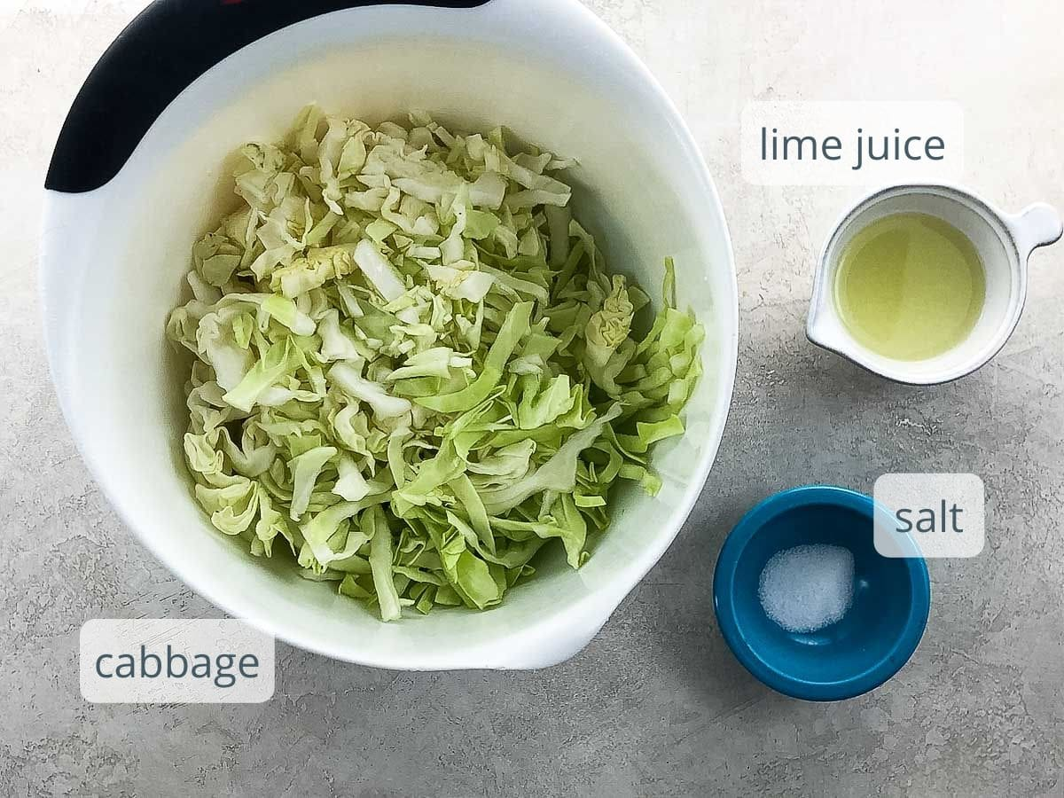 shredded cabbage, lime juice, and salt in bowls