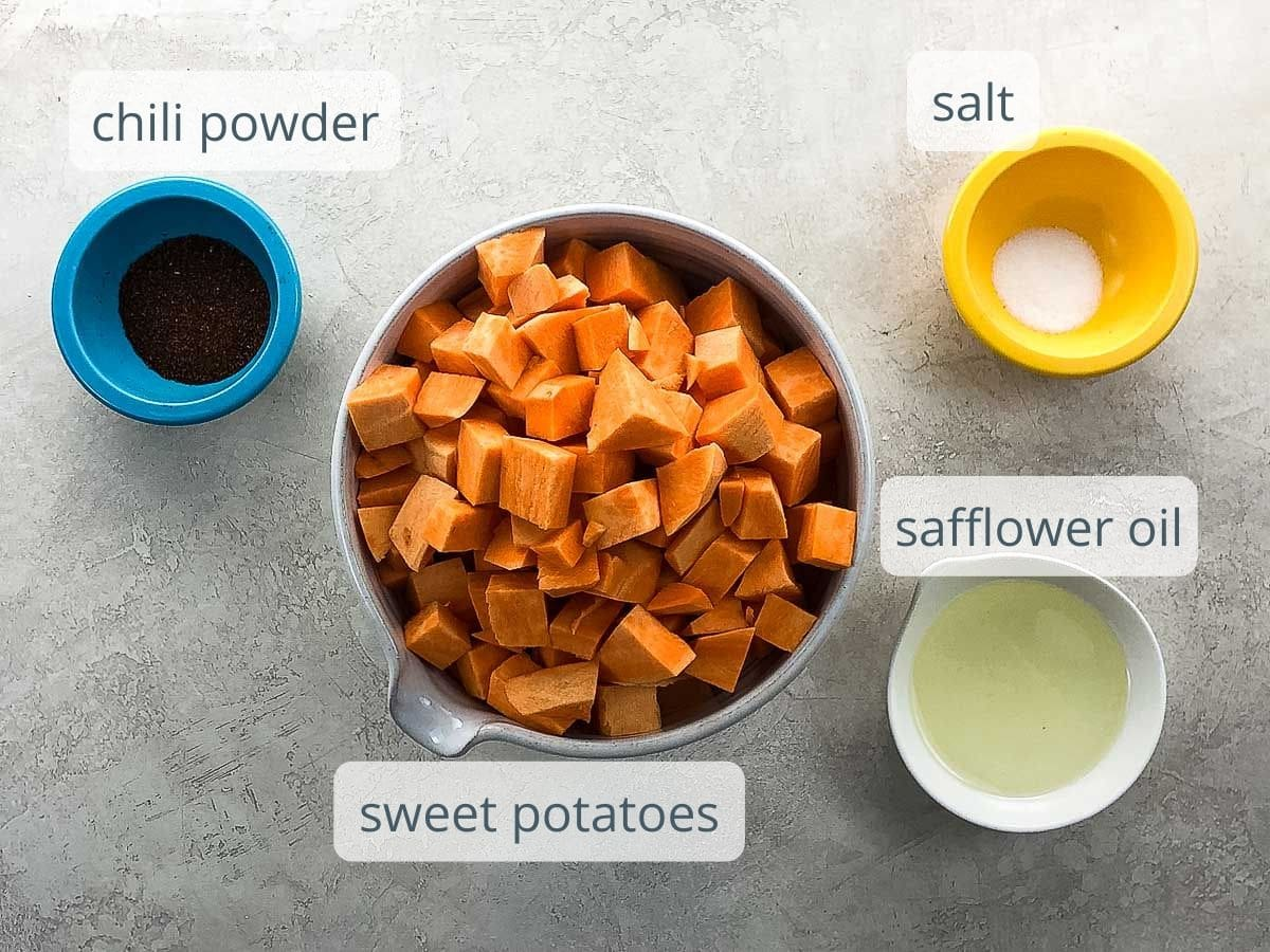 chili powder, diced sweet potatoes, salt, and safflower oil in bowls