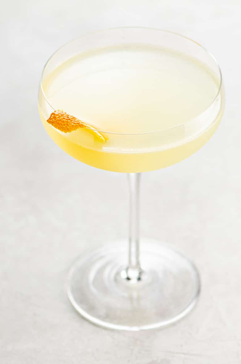 corpse reviver no. 2 cocktail in a coupe glass on a light background