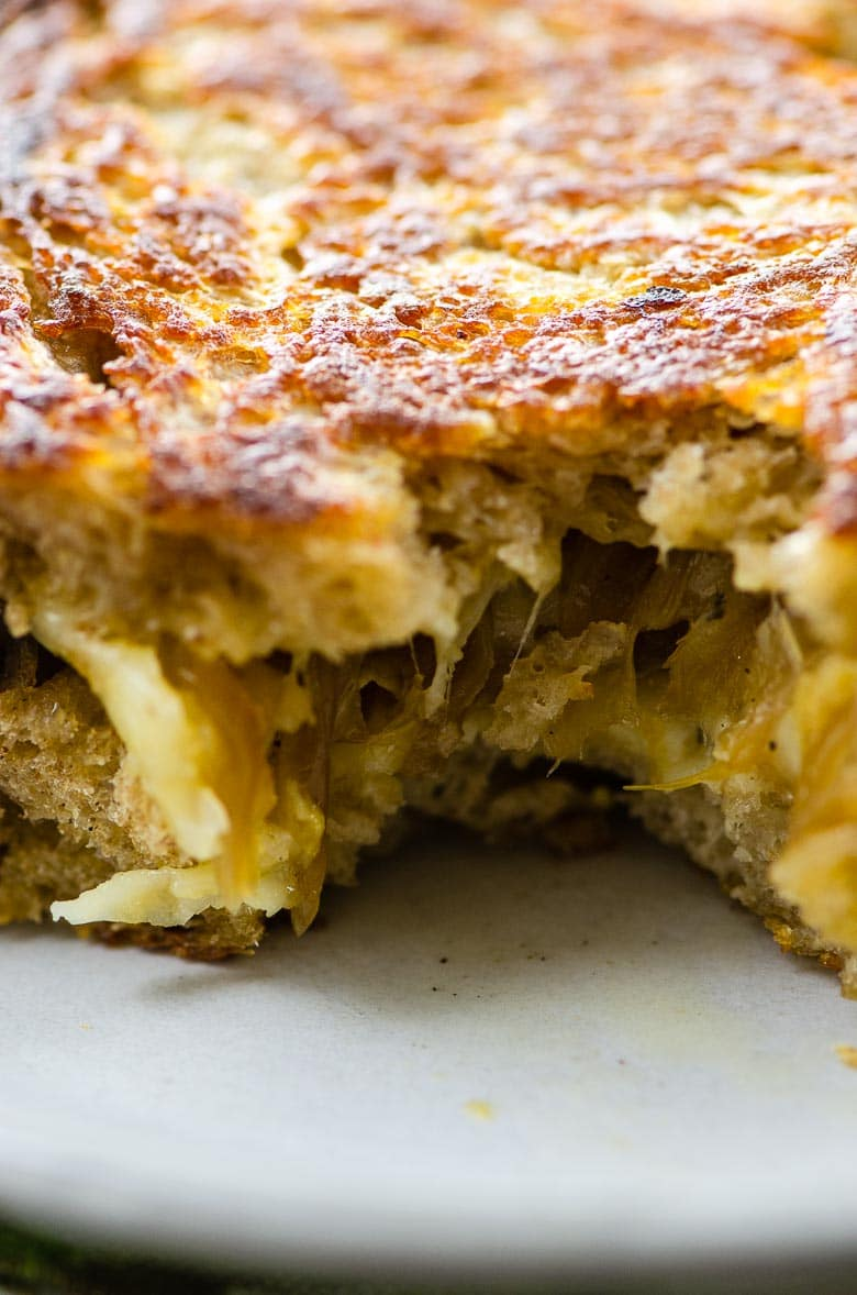 closeup of grilled cheese with a bite taken out of it
