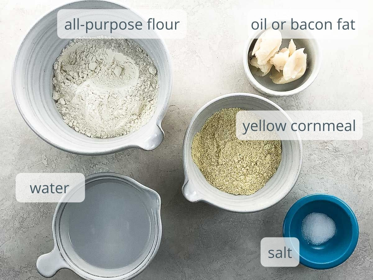flour, yellow cornmeal, bacon fat, water, and salt in bowls