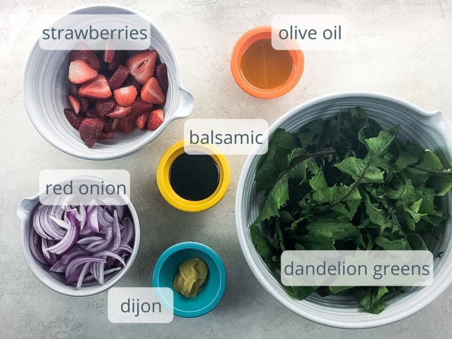 dandelion greens, red onion strawberries, dijon, balsamic, olive oil in bowls