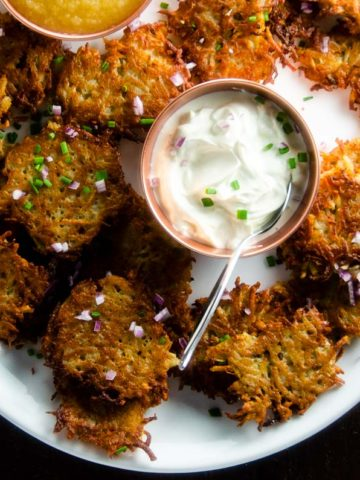 platter of easy potato pancakes with sour cream