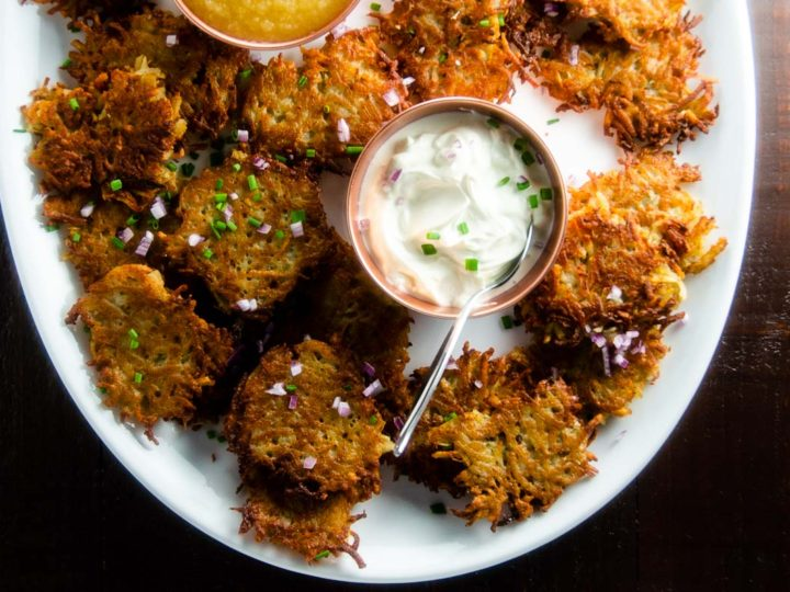 platter of easy potato pancakes with sour cream