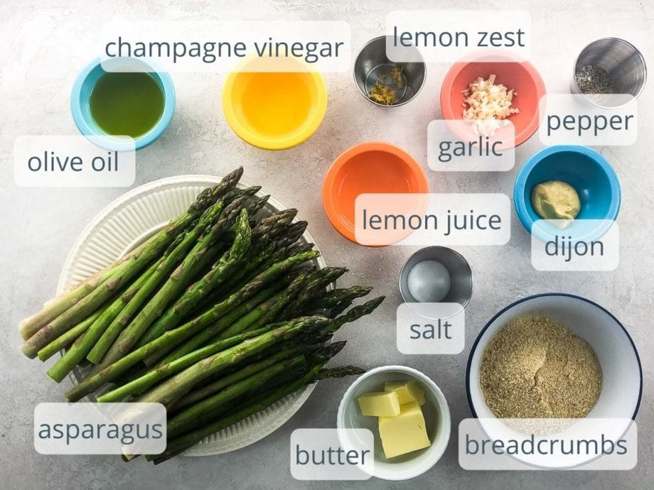 marinade, breadcrumbs, and asparagus ingredients in bowls