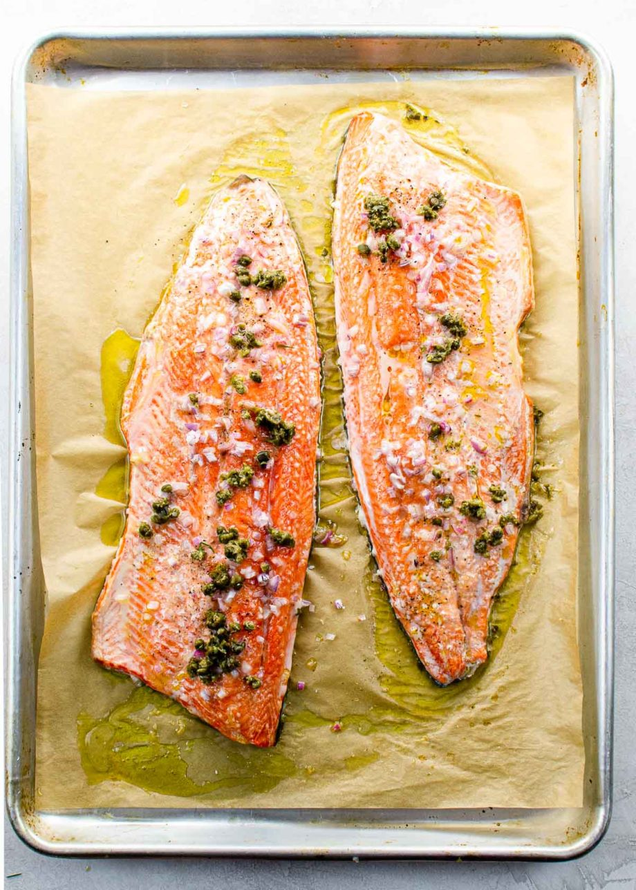 two slow roasted salmon fillets on a sheet pan