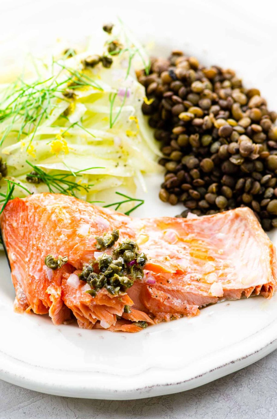 roasted salmon, lentils, and fennel salad on a plate