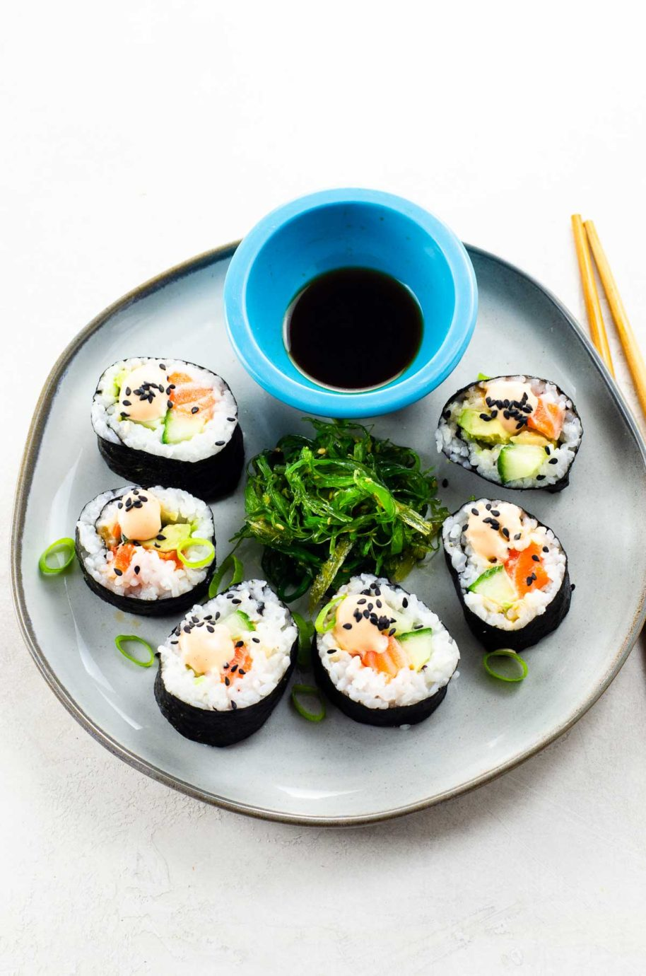 spicy salmon roll, seaweed salad, and soy sauce