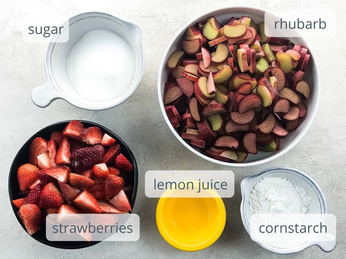 sugar, rhubarb, strawberries, lemon juice, and cornstarch in bowls