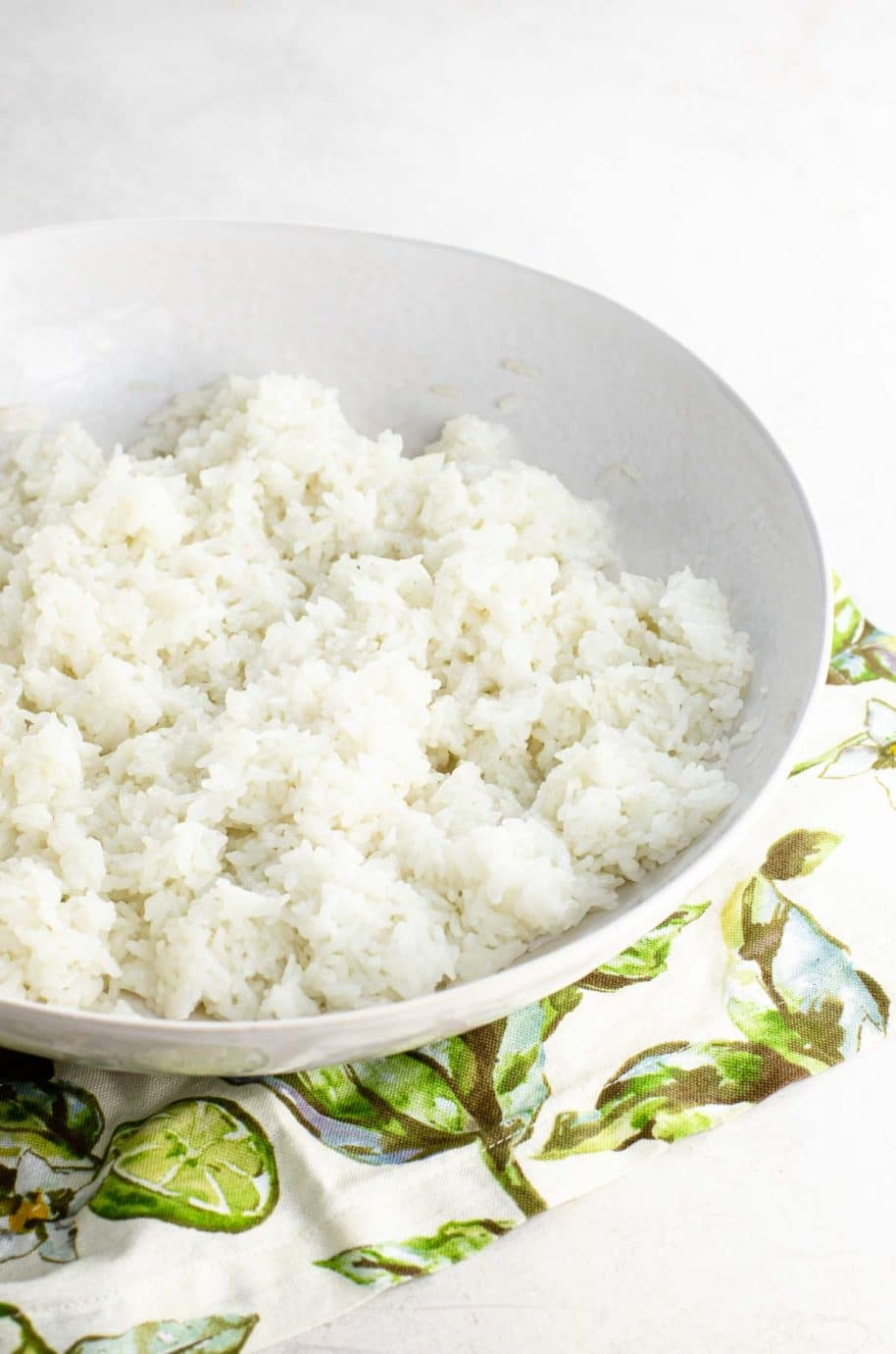 rice in a white bowl over a napkin