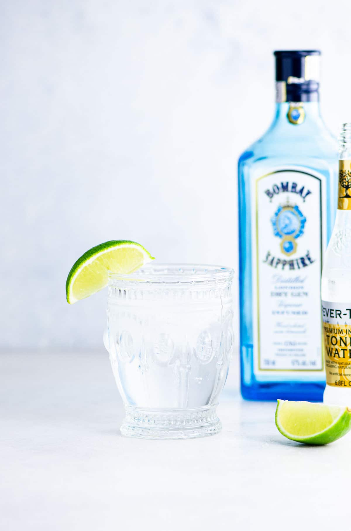 Gin and tonic with lime wedge and Bombay Sapphire