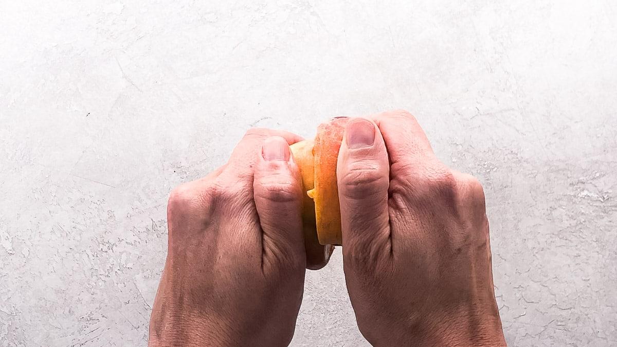 twisting peach halves to separate