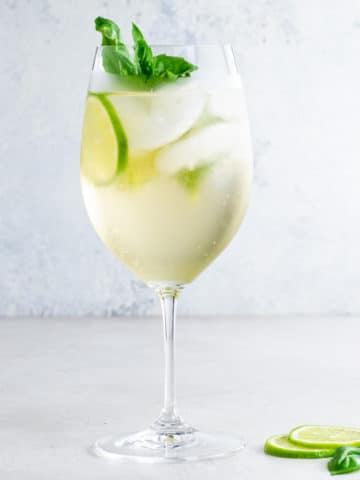 hugo spritz with basil and lime slices