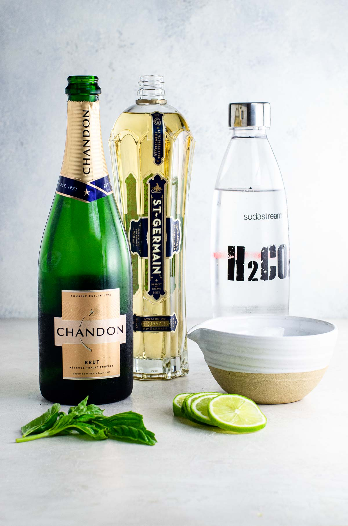 chandon brut, st-germain, sparkling water, basil, lime slices, ice