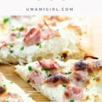 slice of white pizza with ham