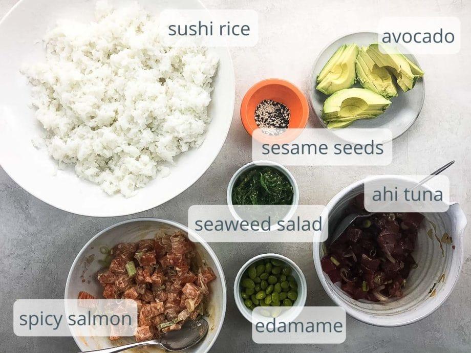 rice, avocado, sesame seeds, spicy salmon, tuna, seaweed salad, edamame