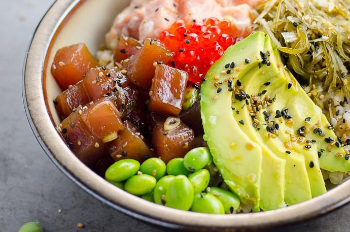 ahi tuna poke bowl with spicy salmon, edamame, avocado, and fish roe