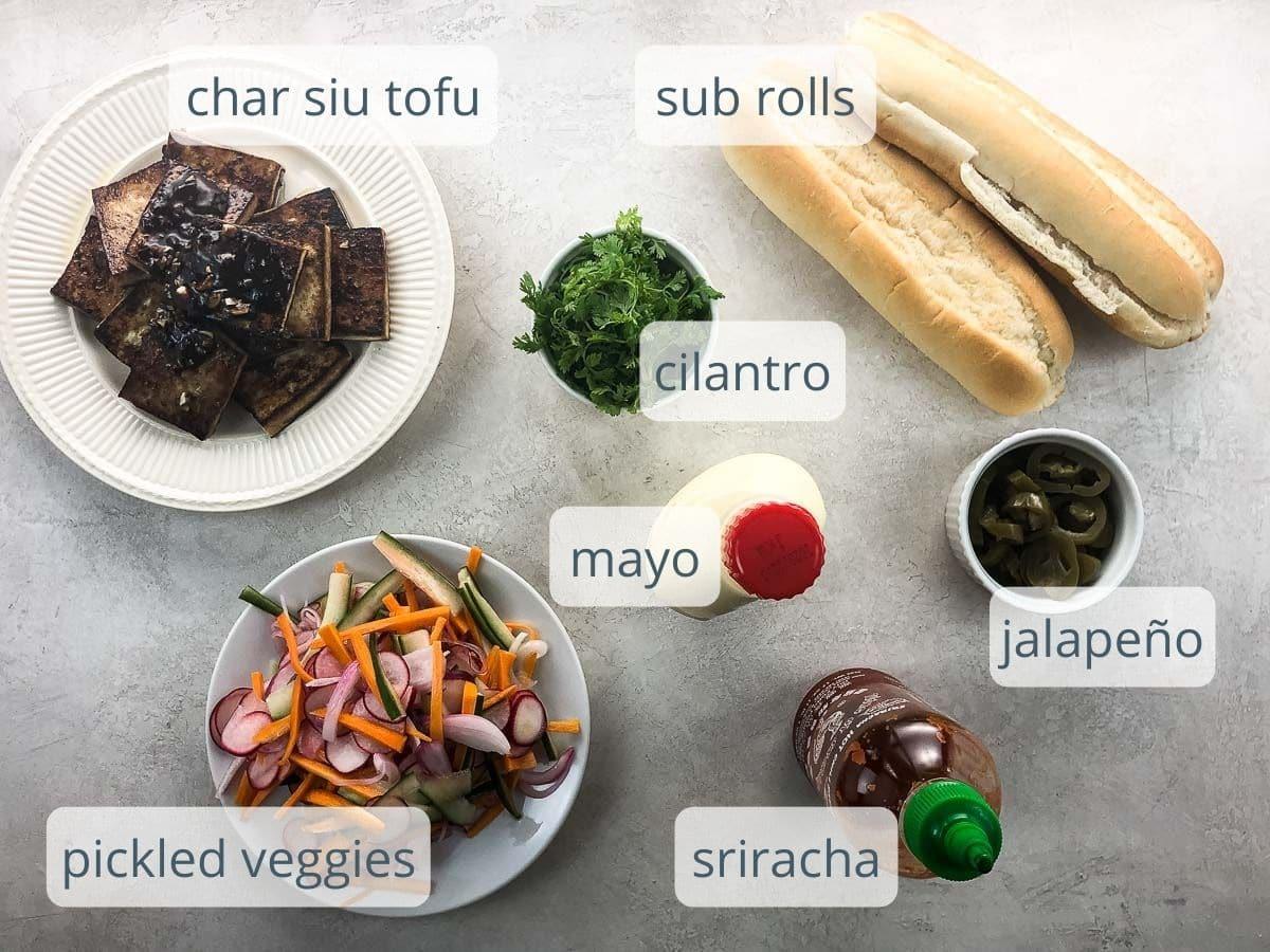 rolls, tofu, cilantro, mayo, sriracha, jalapeño, pickled veggies