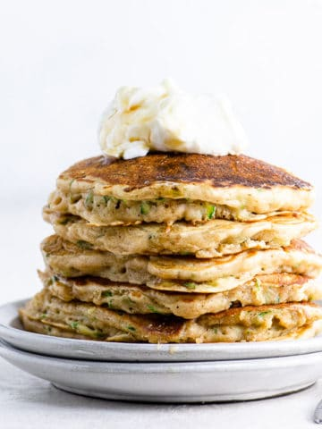 zucchini bread pancakes with yogurt and syrup