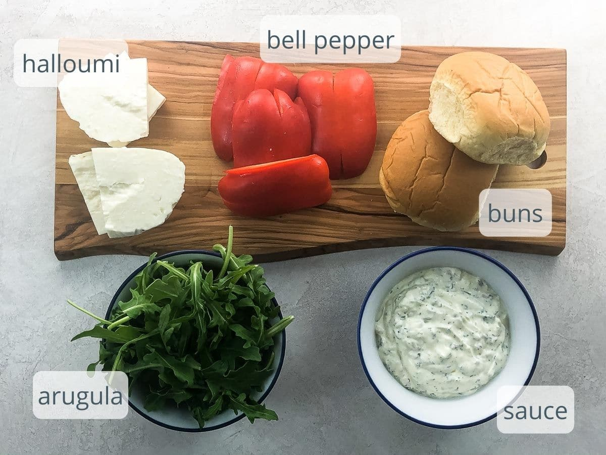 halloumi, red bell pepper, buns, arugula, and herb sauce