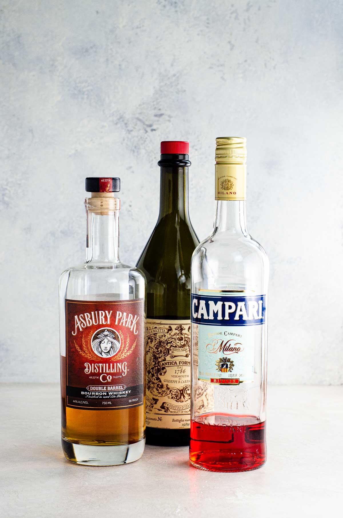 whiskey, carpano antica, and campari